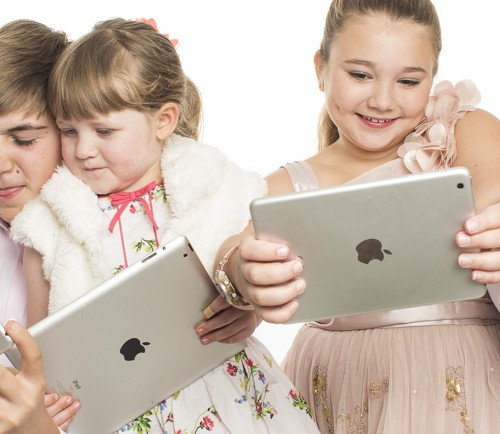 family photography all holding ipads