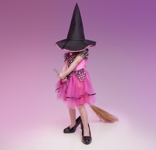 girl dressed as witch pink background family photography