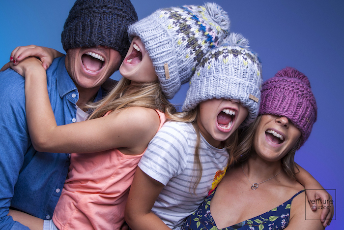 photography of family in wooly hats